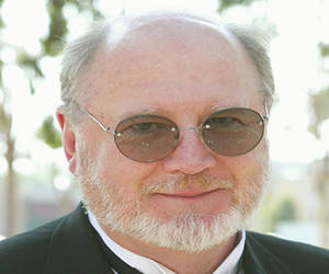 david ogden stiers bald guy wears glasses out of mash
