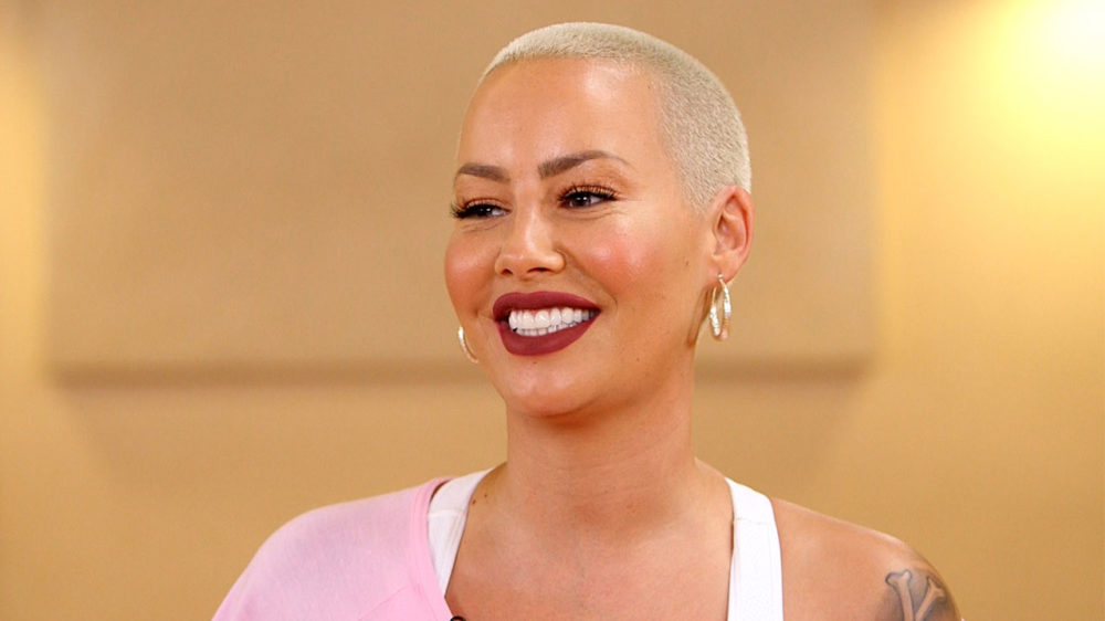 Amber Rose with crew cut smiling bright shiny teeth