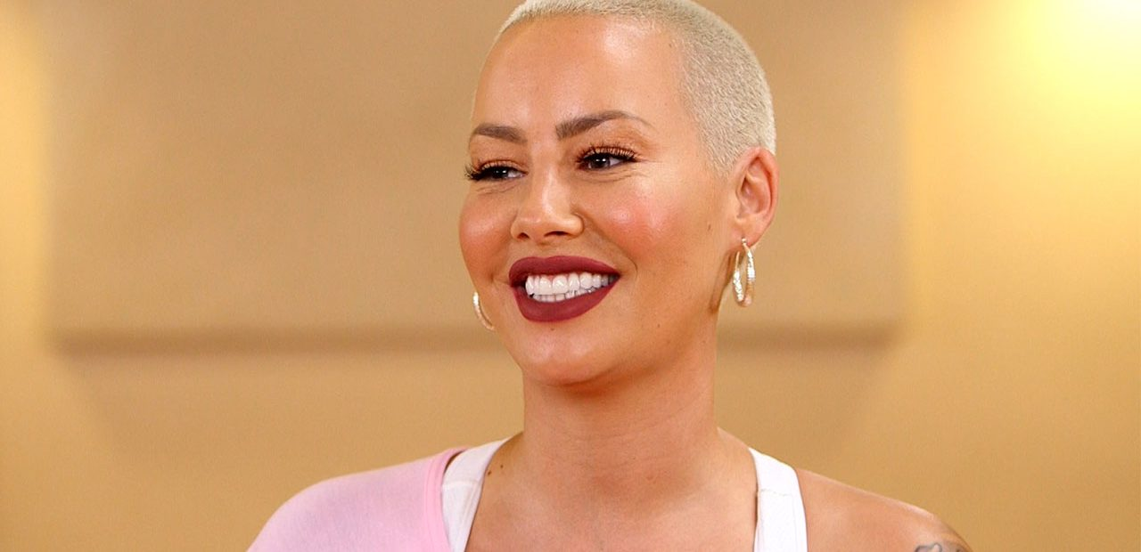 Amber Rose African American model with crew cut smiling bright shiny teeth
