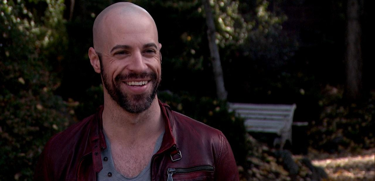 Chris Daughtry receding hairline and short beard smiling