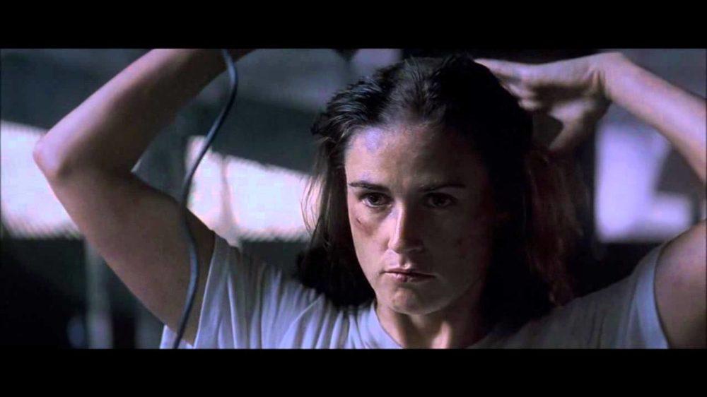 Demi Moore shaving hair off in movie scene from movie gi jane