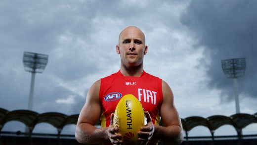 Gary Ablett Jr Australian AFL Player holding rugby ball