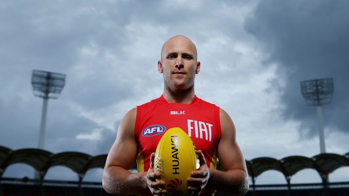 Gary Ablett Jr Australian AFL Player smooth bald head holding rugby ball