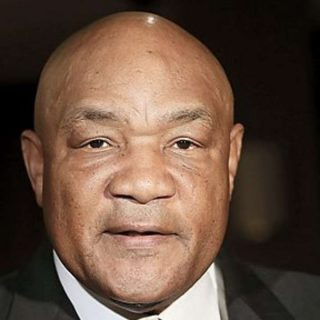 George Foreman African American boxing champion posing for photo
