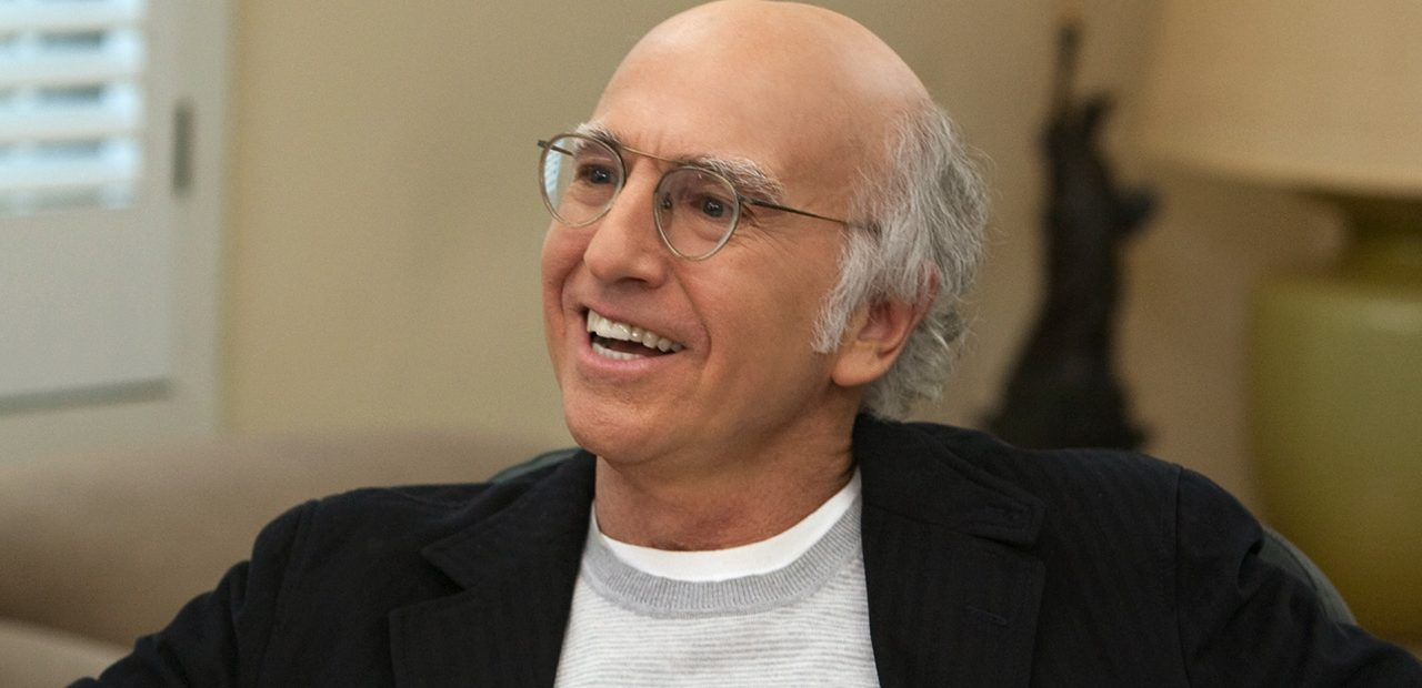 Larry David comedian producer talks about Seinfeld wearing glasses receding white hair