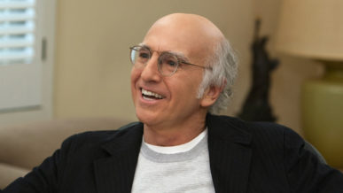 Larry David wearing glasses receding white hair