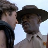 Louis Gossett Jr African American actor wears hat on bald head