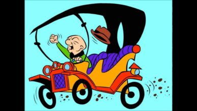 Mr Magoo bald cartoon character driving his car fist in the air