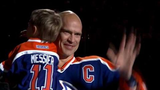 Mark Messier Canadian Ice Hockey Player bald head holding son and waving