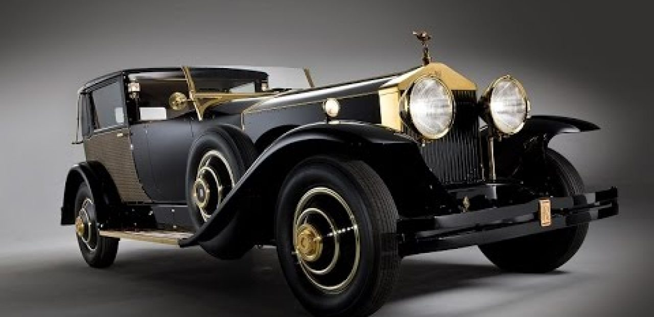Henry Royce Bald People in History pictured is a classic old rolls royce car with gold trim