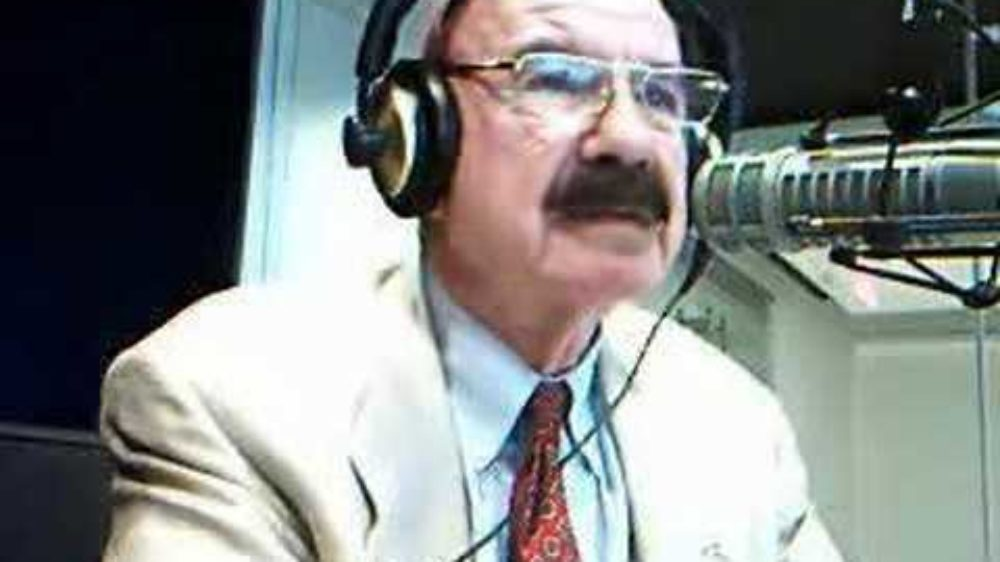 G Gordon Liddy talking into microphone