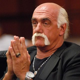 Hulk Hogan professional wrestler appearance in court hands together like he is praying