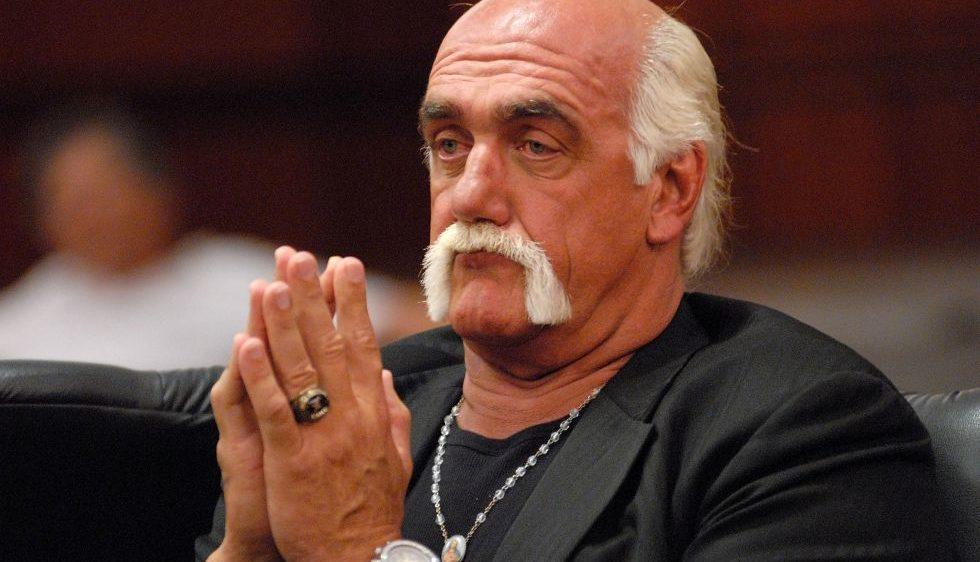 Hulk Hogan professional wrestler appearance in court hands together like he is praying