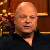 Michael Chiklis sitting