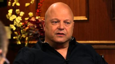 Michael Chiklis sitting