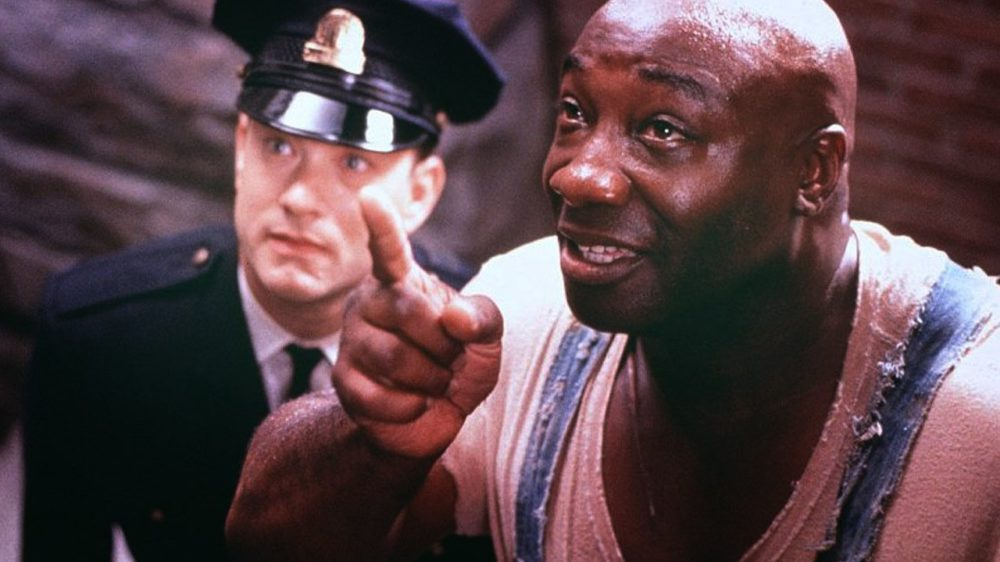 Michael Clarke Duncan scene from The Green Mile movie with tom hanks in background