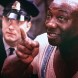 Michael Clarke Duncan dead African American actor scene from The Green Mile movie with tom hanks in background