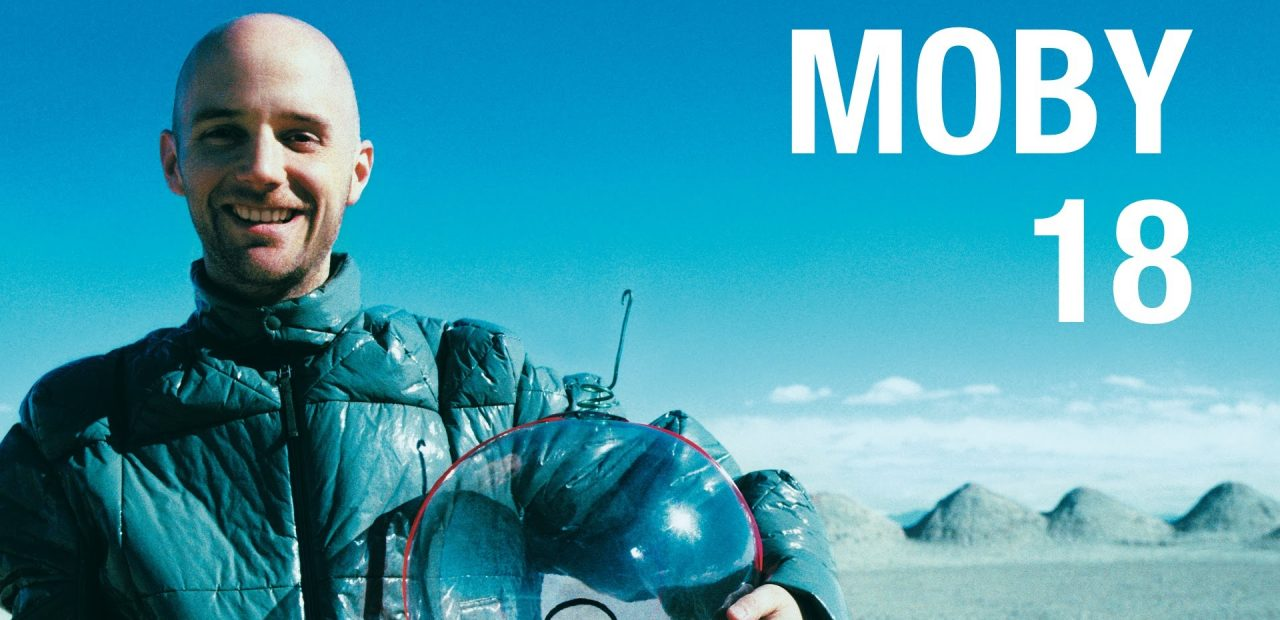 Moby posing with clear helmet