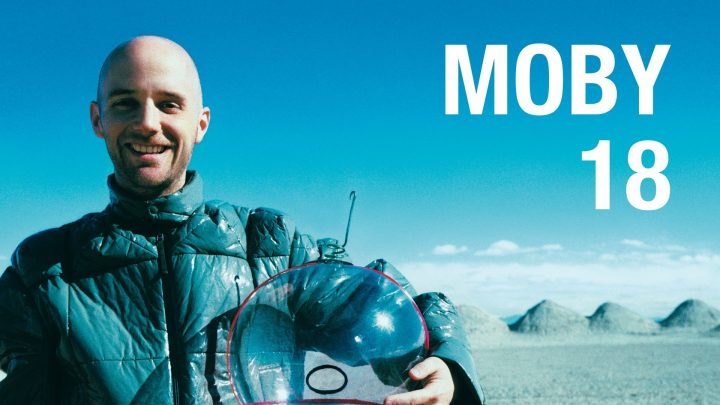 Moby American DJ Musician posing with clear helmet
