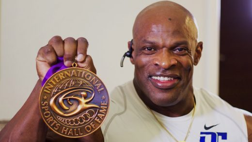 Ronnie Coleman black African American bodybuilder holding up International Sports Hal of Fame medal