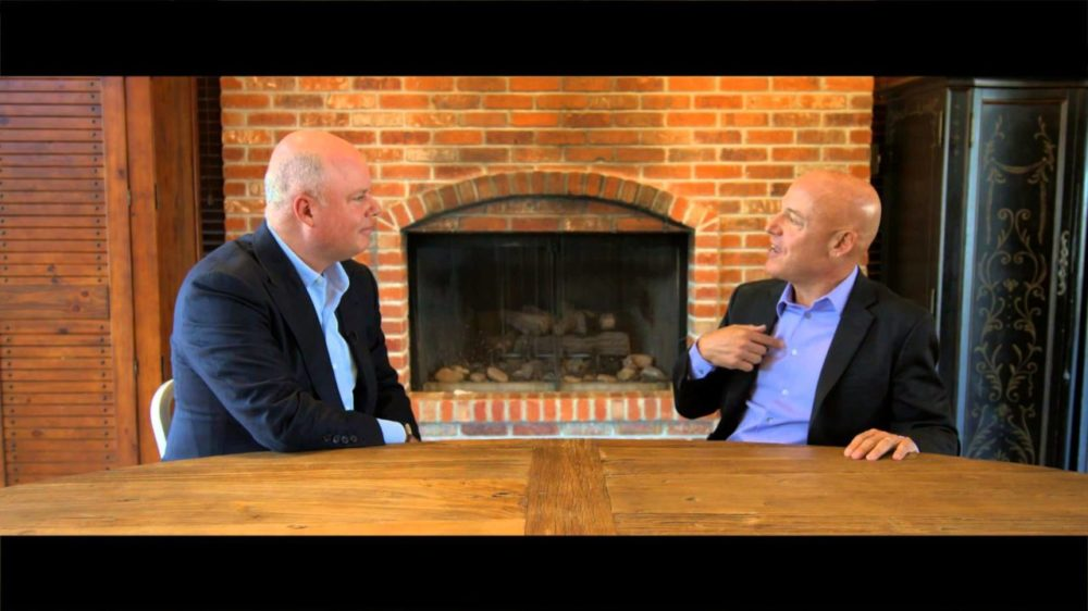 Paul Zane Pilzer interview at large wooden table