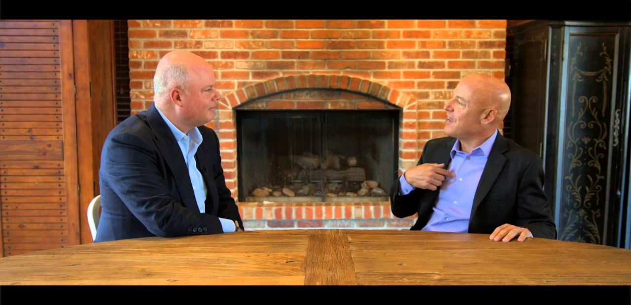Paul Zane Pilzer Entrepreneur Economist Author interview at large wooden table