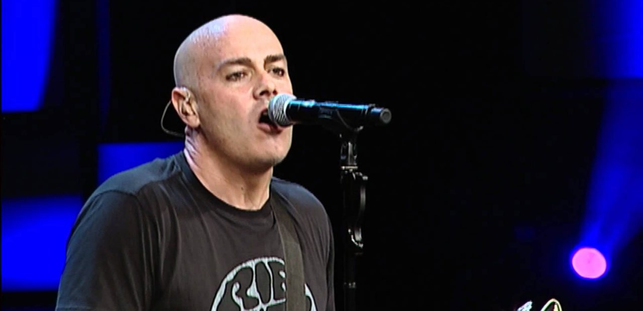 Peter Furler christian musician singing while playing guitar