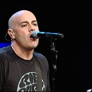 Peter Furler christian musician singing while playing guitar