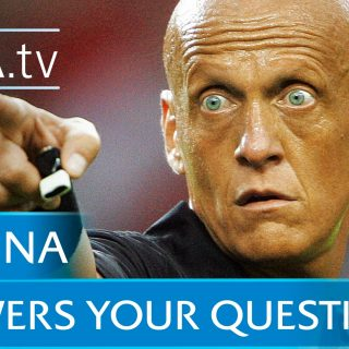 Pierluigi Collina totally bald Italian Football Referee pointing while holding whistle