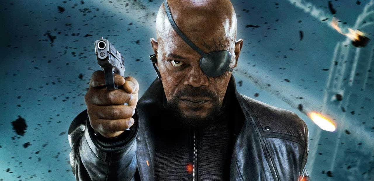 Samuel L Jackson African American actor scene from movie appears bald wearing eye patch and pointing gun