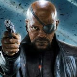 Samuel L Jackson African American actor scene from movie wearing eye patch and pointing gun