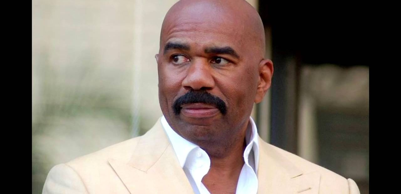 Steve Harvey bald black tv host with big moustache