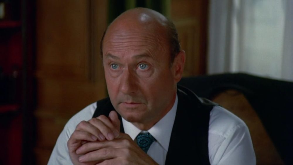 Donald Pleasence frowning with Bald Head