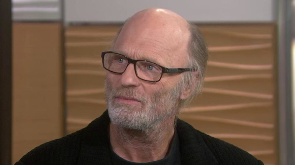 Ed Harris Bald Head wearing glasses with short grey beard