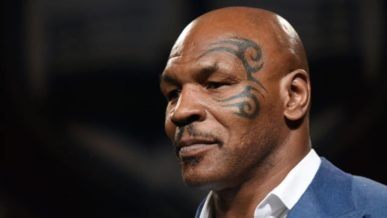 Mike Tyson Bald Head and face tattoo